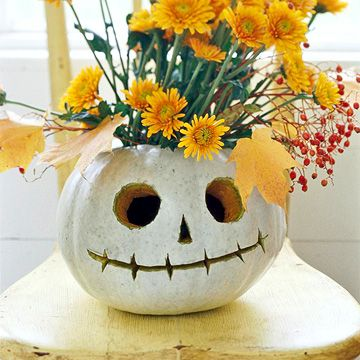 Cute on a patio table! I'm loving white pumkins this year!