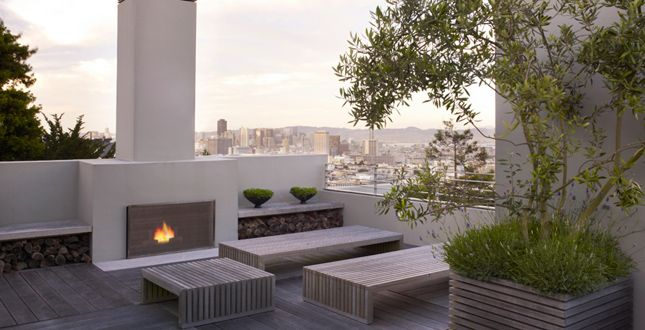 One dream is to add a roof deck.  I love the outdoor fireplace.