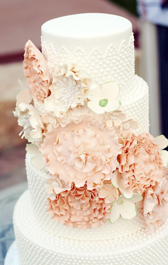 Peach Ruffle Flowers on White Swiss Dotted Wedding Cake