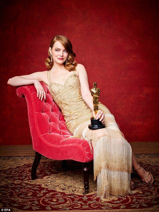 Star quality: Emma Stone, 28, exuded Old Hollywood glamour as she reclined in a red chaise...