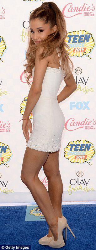 Sixties style: Ariana Grande looked adorable in a super short white dress and beige platfo...