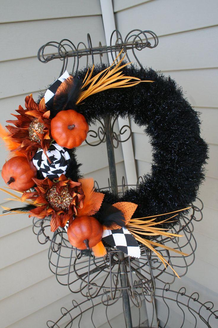 Fall Yarn Wreath/Fabric Flowers/Pumpkins/Feathers.  via Etsy.