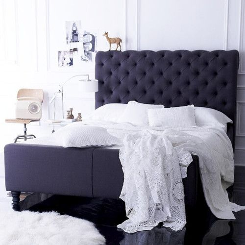 soft navy tufted headboard; soft navy tufted sleigh bed; all white linens on a navy bed
