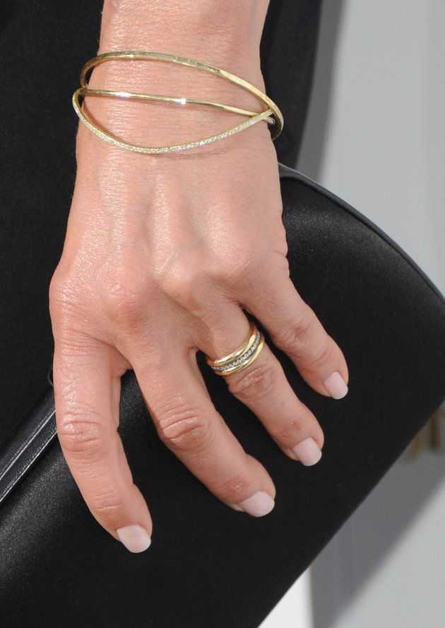 "Jennifer Aniston flashes her wedding ring for the first time since saying ""I do."""