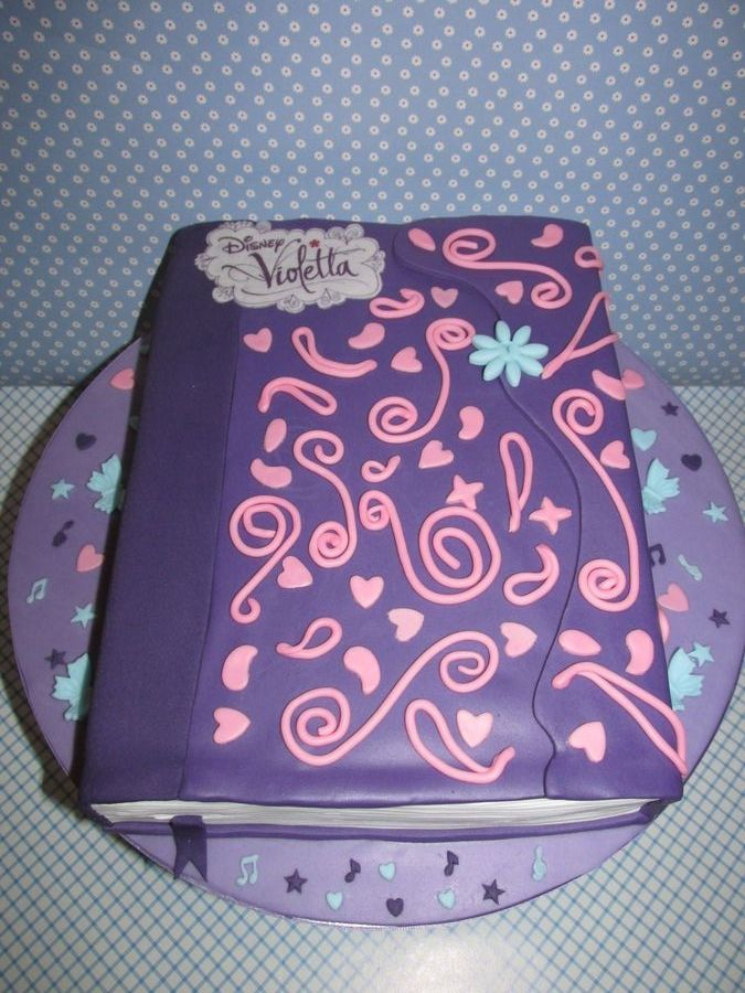 Violetta´s Diary - Yellow cake, covered in chocloate ganache and decorated with fondant.