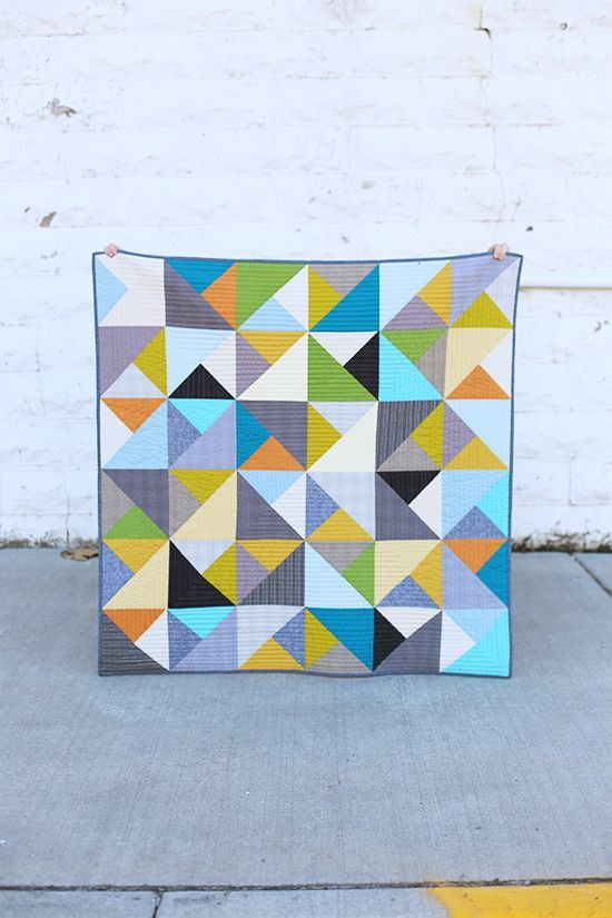 This is a baby quilt made without a pattern. And then it was quilted with straight lines. Easy peasy!