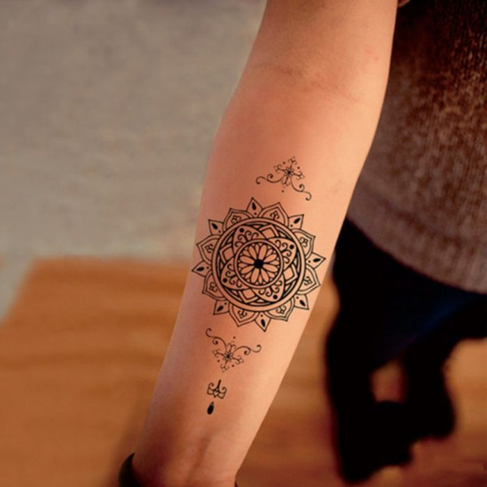 young woman with mandala tattoo on her forearm small tattoo on her lower arm with mandala    #Uncategorized #tattoo