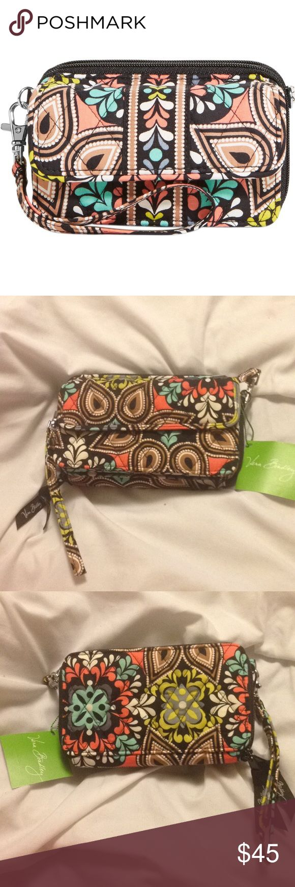 All in One Crossbody for iPhone 6 Brand new with tags - never been used / purchased at Vera Bradley store : print: Sierra / comes with wristlet strap and crossbody strap (both straps are detachable) / 3 in 1 wallet - wristlet - crossbody / front magnetic close pocket perfect fit for iPhone 6  / one zip compartment has two slip pockets and a zipped coin pocket / other zip compartment has large bill pocket, 8 cc slots and clear ID slot / crossbody strap is adjustable Vera Bradley Bags…