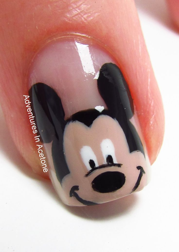 """M-I-C-K-E-Y is """"mouse shaped silver holo glitters, mixed with various sized hex glitters in red, black, white, and yellow, sprinked with micro holo glitter ..."""