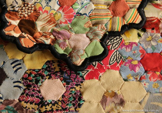 The blanket stitch edging of Lil Evans' glorious hexagon quilt made in the the 1940's.