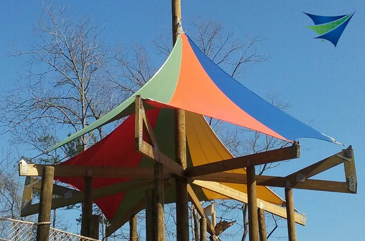 Colorful shade sails for tree house at zoo for Colorful tree house