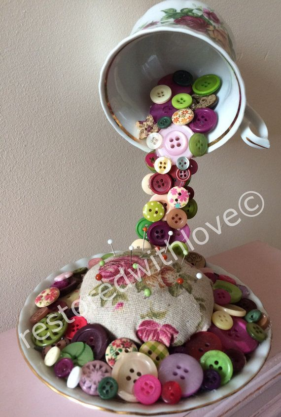 Stunning handmade one of a kind mixed media China teacup with flowing colourful buttons , surrounding the handmade useable pin cushion!  Would look great in a shop or as home decor or as stated before a useable piece of art! Size 8tall 7 wide 5.5 depth I also have a floral floating tea cup available for sale