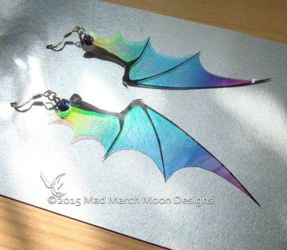 Dragon wing earrings, stunning, different and a sure fire hit for any dragon lover.  Made from lightweight acetate layers they are iridescent and