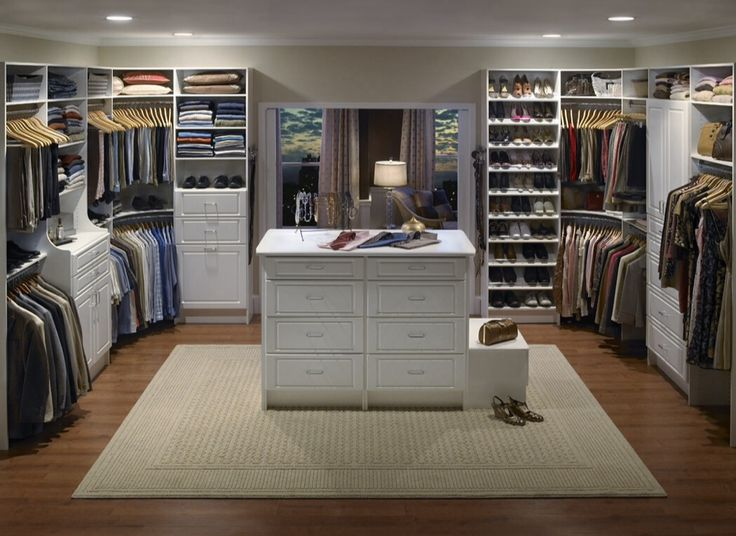 Traditional Closet with Walk in closet, Neutral area rug, Hardwood floors, Pottery barn sutton closet island, Open shelves