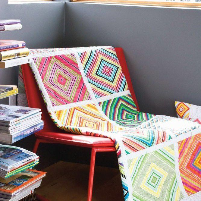 striped fabrics in this modern quilt featured in modern patchwork magazine