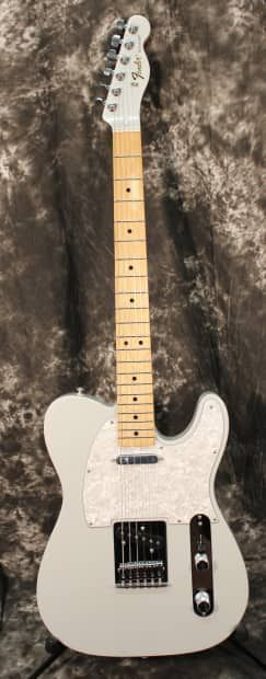Professional guitarists in all musical genres have relied on the Fender Telecaster guitar since its early 1950s introduction for its powerful tone and smooth playability. Now available in a Special Edition White Opal finish with pearloid pickguard and matching headcap, the Standard Telecaster combines the best of old and new, with hotter single-coil pickups, shielded body cavities, medium jumbo frets, six-saddle strings-through-body bridge, cast/sealed tuners, tinted neck, parchment…