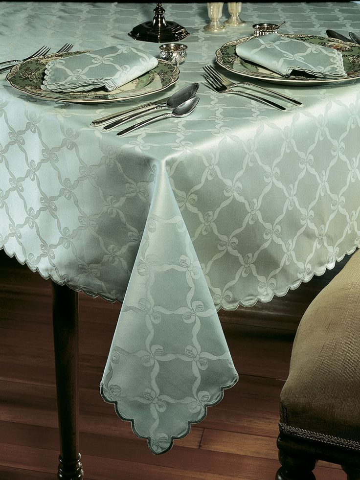 Astor - #Luxury Table Cloths - Ageless ribbon and bow damask glistens luxuriously on pure 1060 thread count Egyptian cotton #tablecloths and #napkins. Imported from Italy in White, Blush, Ivory, Mint Green, or Smoke Blue with soft scalloped edges.