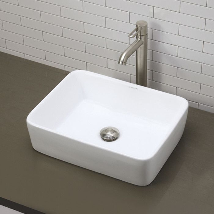 Features:  -Shape: Rectangular.  -Faucet and drain not included.  -Vitreous china is glazed and double fired for durability and stain resistance.  Installation Type: -Vessel sink.  Style: -Contemporar