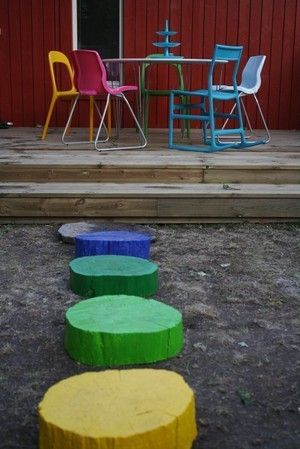 "Painted wood stepping ""stones"" for the backyard. Maybe not such bright colors but still a great idea! could even have some fun and add glitter or something."