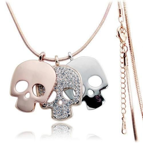 The Triple Skull Pendant Necklace is perfect for the girl who loves edgy accessories with a girly twist.