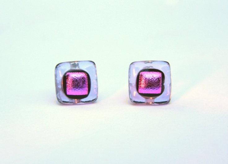 Paula Woodward - DESCRIPTION:    These studs are made from a top layer of magenta Dichroic glass fused with a rich translucent lilac glass. They are mounted on sterling silver earposts and match the Lilac Layered Necklace. £10