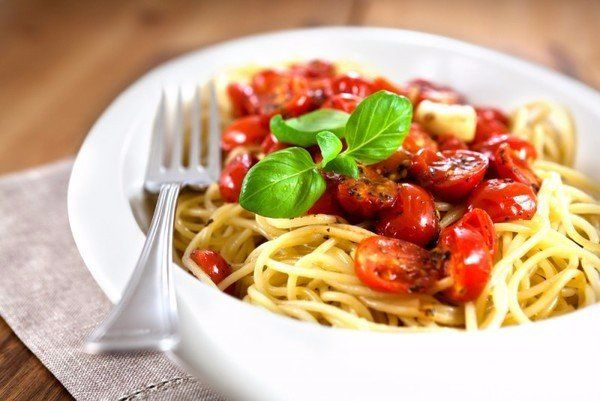 Pasta with cherry tomatoes, olives and Parmesan cheese