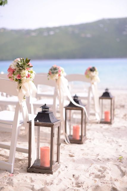 Beautiful wooden lanterns with coral pillar candles lining the aisle. #beach #wedding