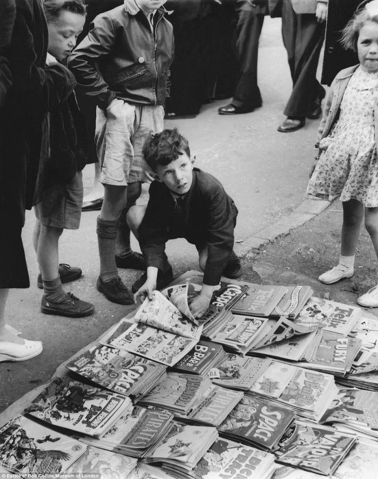 Collection: Children gather around a pile of comics for sale at Romford Market in around 1947. This is one of Mr Collins' earliest works, when he was still a watchmaker