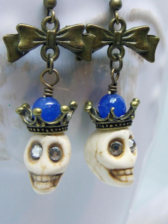 These Fun Skull Earring will be the hit of the party. Wear them with your favorite jeans and sweater for the festivities to begin! Rhinestones eyes add some extra bling to ... #boho_earrings #day_of_the_dead #earrings #funky_earrings #goth_jewelry #halloween_earrings #jewelry #lapis_lazuli_gems #magnesite_skulls #skull_earrings #skull_jewelry #sugar_skull_earrings #victorian_earrings #victorian_era_skull #white_skull_earrings