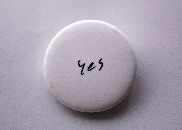 """Yes"" button by Yoko Ono for McDonough Museum of Art, Youngstown, Ohio"