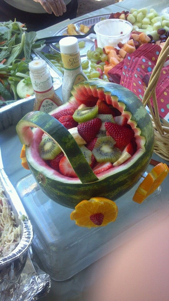 Baby Carriage II with watermelon and assorted fruit. Great idea for a Baby Shower, a Christening or to welcome the baby home.  Made by Vincent Angelo Zahler