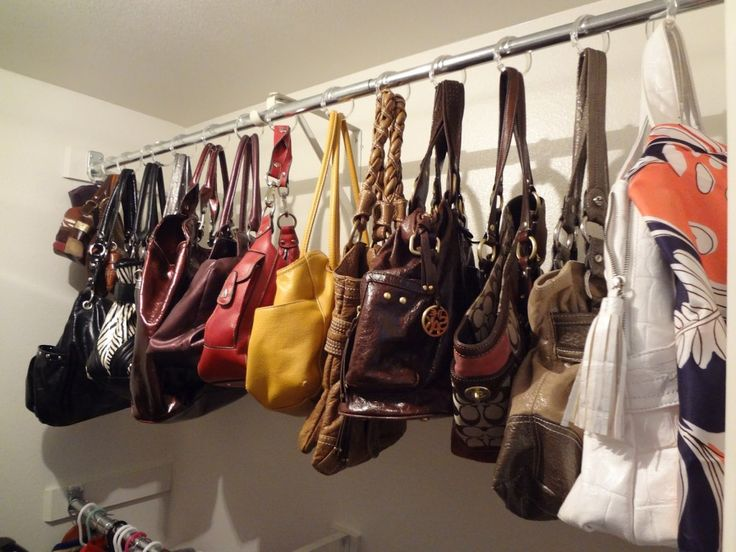 purses hung on rod with shower rings