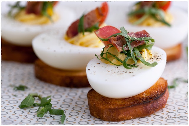 BLT Deviled Eggs. You do need to translate the recipe but this is GENIUS!