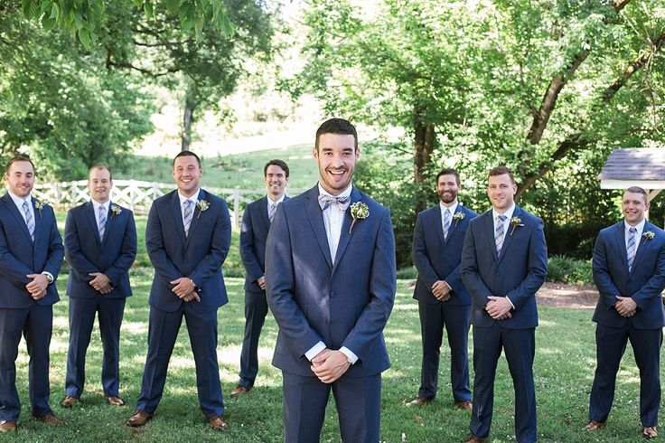 Groom and groomsmen in dark grey suits with white shirts and plaid ties.   A Summer Garden Wedding In Knoxville | Bride Link