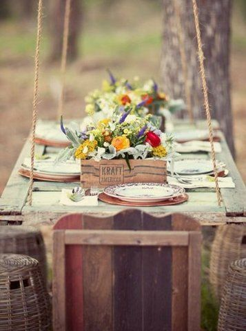 I love the idea of hanging an old door between two tree branches for an outdoor picnic spot in the yard!