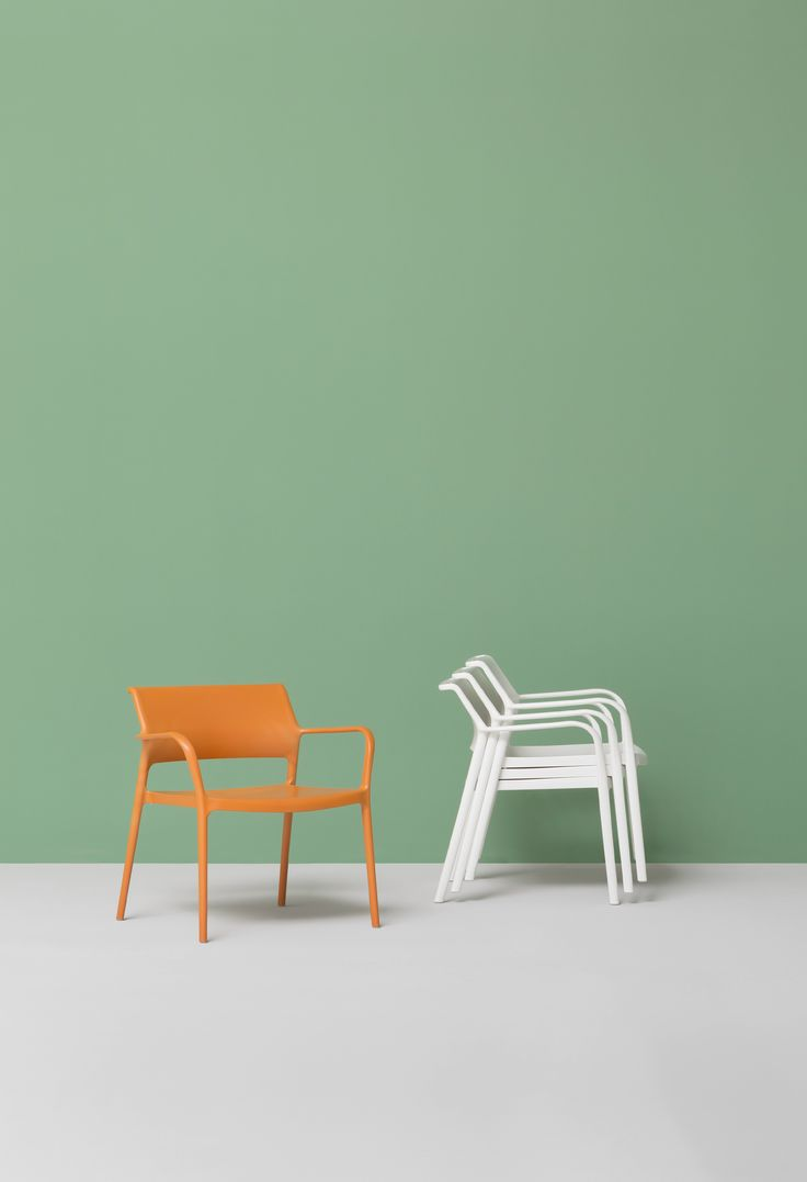 Stackable polypropylene easy chair with armrests ARA LOUNGE by PEDRALI design Jorge Pensi