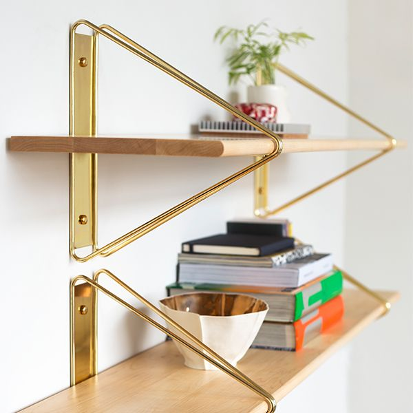 Modern minimalism meets classic architectural construction in the Strut Shelving System.
