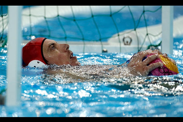 Dragos Stoenescu of Romania reacts after Rob Parker of Great Britain scored a goal on him in a preliminary water polo match at the 2012 Summer Olympics, Sunday, in London.