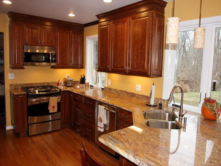 Admirable Kitchen Paint Colors Popular And Beautiful Design And Photos:  Brilliant Brown Finished Kitchen Cabinets Also Marble Countertops As Well  As Yellow ...