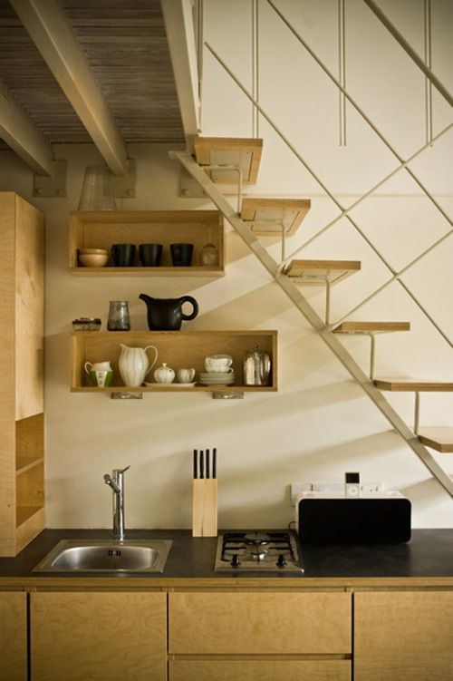 Understair Kitchen http://www.myhomerocks.com/2012/03/beautiful-laid-back-home-design-by-ekaterina-voronova/
