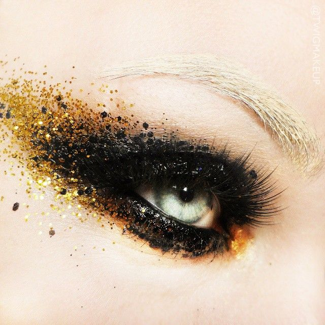 Black and gold glitter eye make up