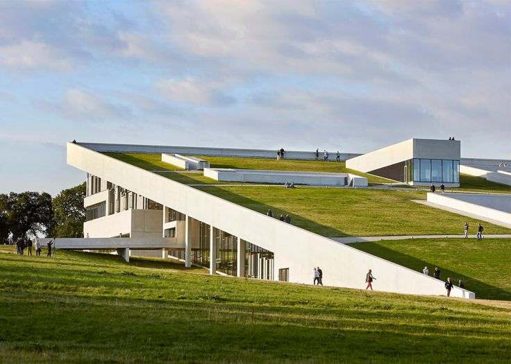 These new shots by photography duo Hufton + Crow show visitors climbing the grass-covered sloping roof of the Moesgaard Museum near Aarhus, designed by Danish firm Henning Larsen Architects