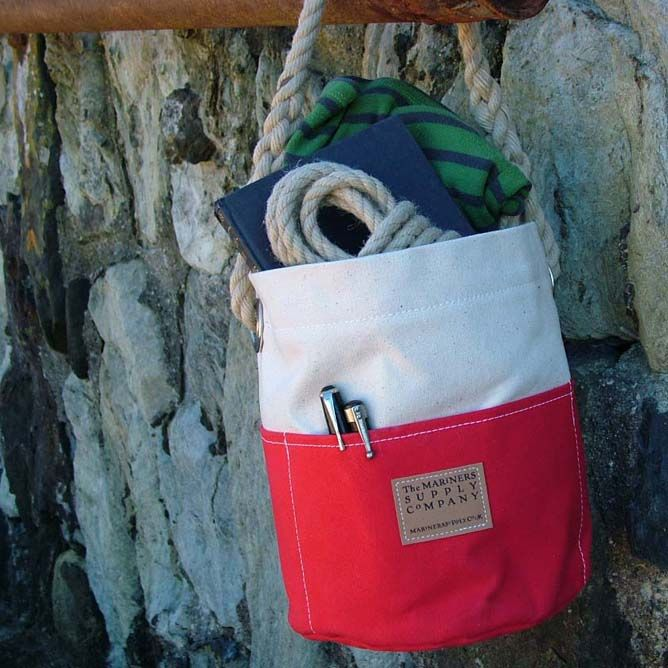 Small Ditty Bag - Two Tone Traditionally used by sailors onboard ship the Ditty Bag has outside pockets, a hand-spliced rope handle and sturdy nickel eyelets - perfect for gardening tools, artists materials, or any collection of bits and bobs in need of a home. <br> <br> Now available in cream with red, blue or green pockets. Ditty Bags and Duffle Bags > Small Ditty Bag - Two Colour The Mariners Supply Company - unique canvas bags and goods made in Falmouth, Cornwall