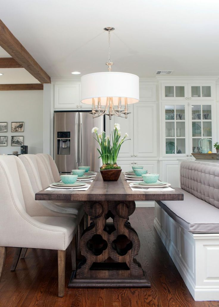 Banquette attached to island.  Love.  Chip and Joanna Gaines help a young couple turn a run-of-the-mill 1958 ranch house into a charmer of a first home with lots of light, color and wide open space.