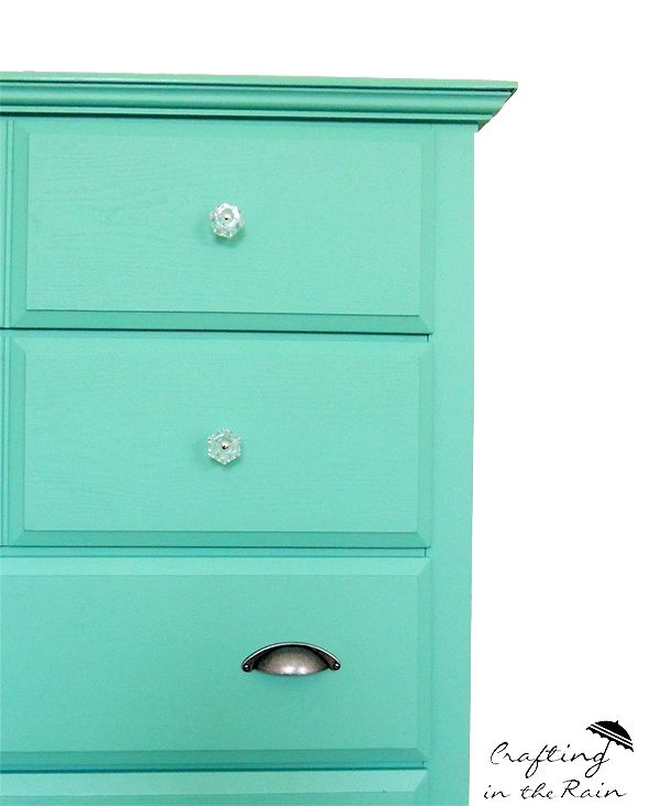 This teal dresser makeover from Crafting in the Rain matches our glass cabinet knobs with D. Lawless brand cup pulls. Great look at a great price! Especially since the dresser came from Craigslist!