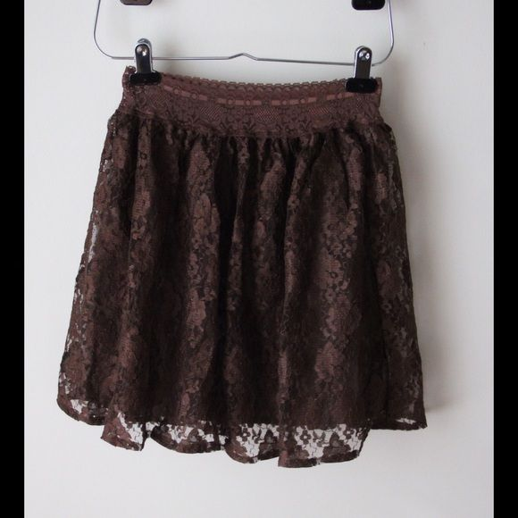 """Brown lace skirt Chocolate brown lace skirt - elastic waistband - lined - allover lace overlay - waist across without stretching measures 12"""" and stretches to 14"""" - total length measures 17"""" - would look super cute with some cowgirl boots! - polyester outer, cotton lining - size XXS Old Navy Skirts Mini"""