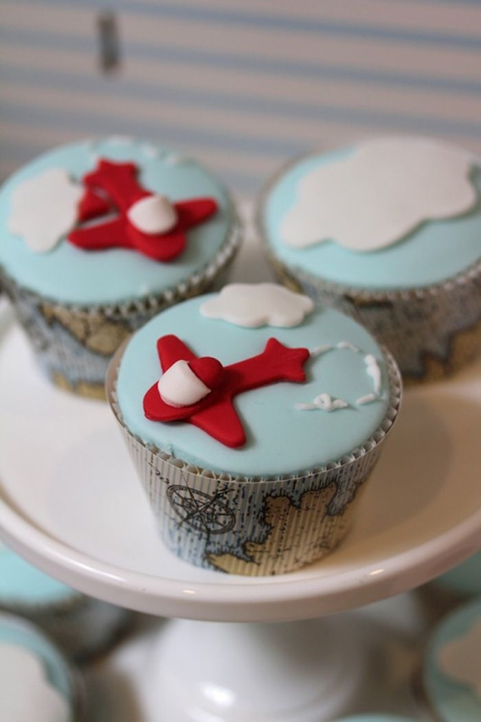 Cute CUPCAKES from this Up & Away Travel Themed 1st Birthday Party {Planning,Decor, Ideas} via Kara's Party Ideas KarasPartyIdeas.com #airplanecupcakes #travel #flying
