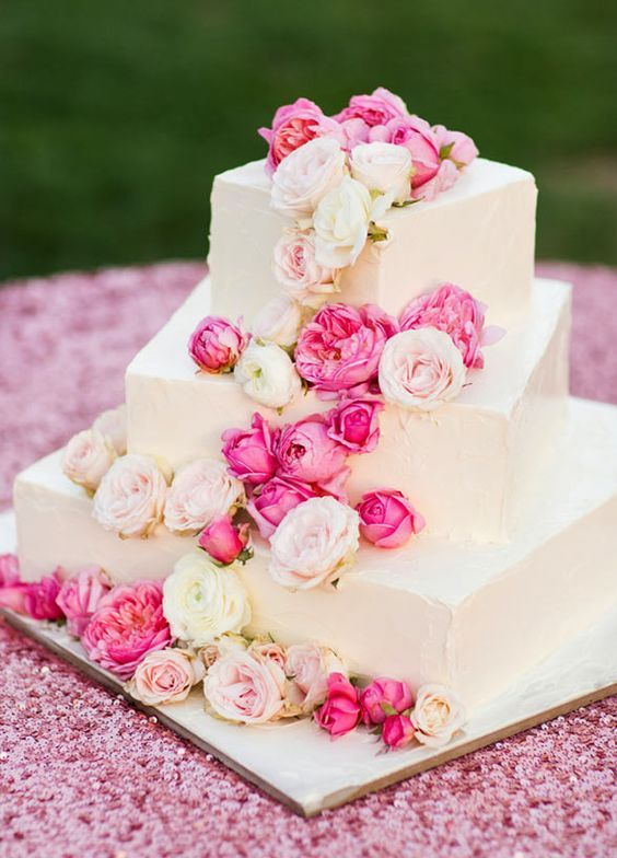 Pretty in pink three tier square wedding cake dresses in elegant flowers; Featured Photographer: Jonathan Young
