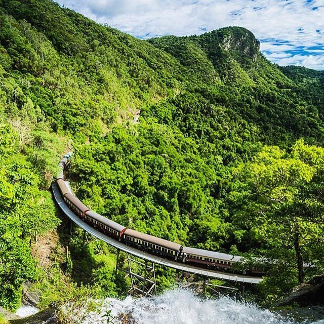 Kuranda Scenic Railway in Australia. This famous railway winds its way on a journey from Cairns to Kuranda, the village in the rainforest. A very enjoyable journey with train through magnificant rainforests and hills.