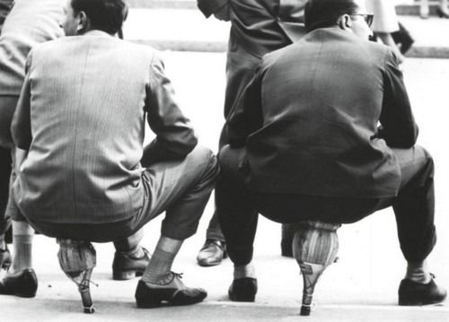 Milan 1949 Mario De Biasi. It took a minute to realize they are sitting on Chianti wine bottles...